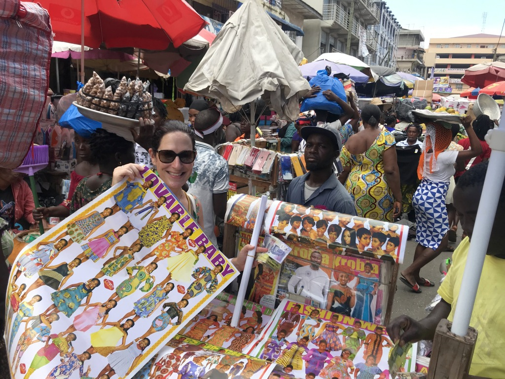 Posters for seamstresses, of outfits to sew, being sold at Makola Market Accra