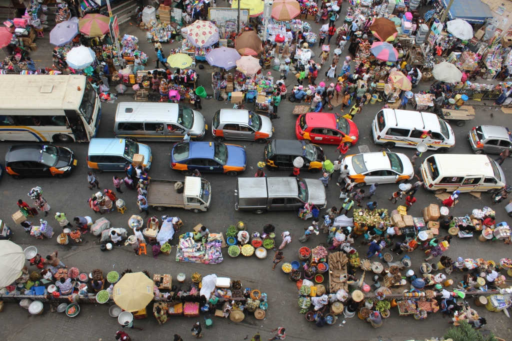 A view of Makola market Accra taken from above, of the many vendors and cars lining the streets