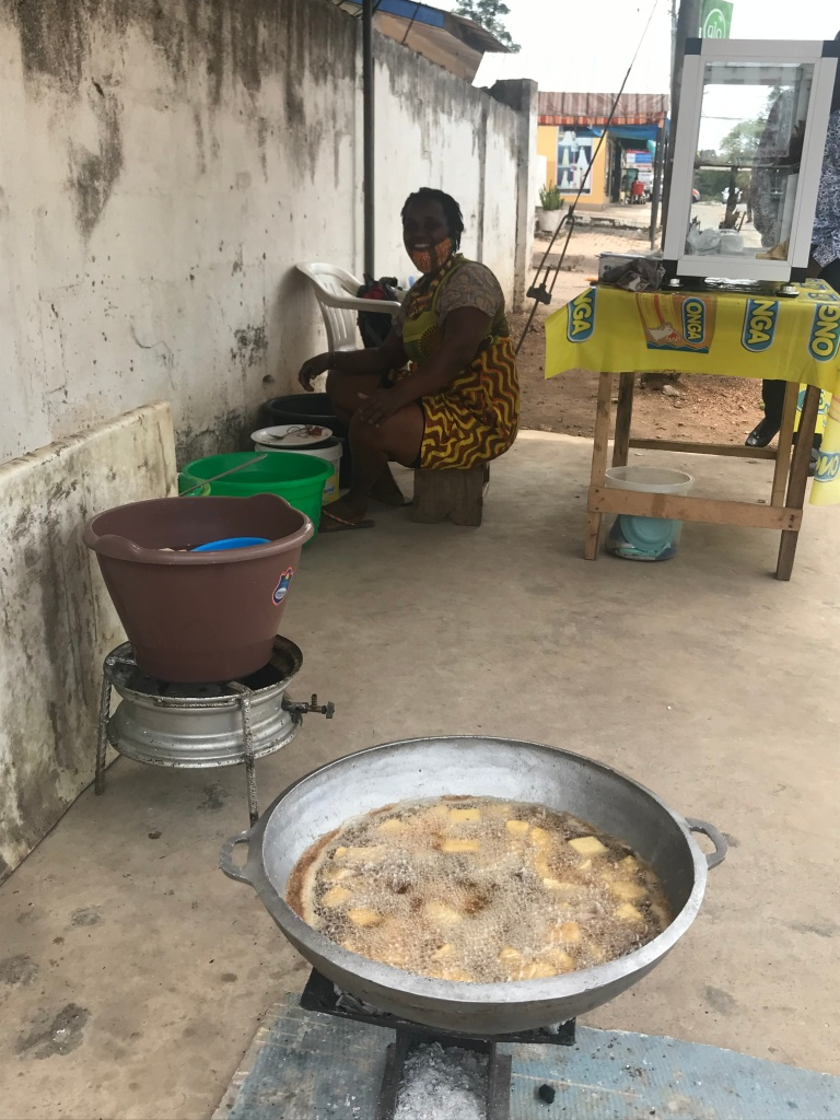 Ghanaian lady selling yam chips in Accra