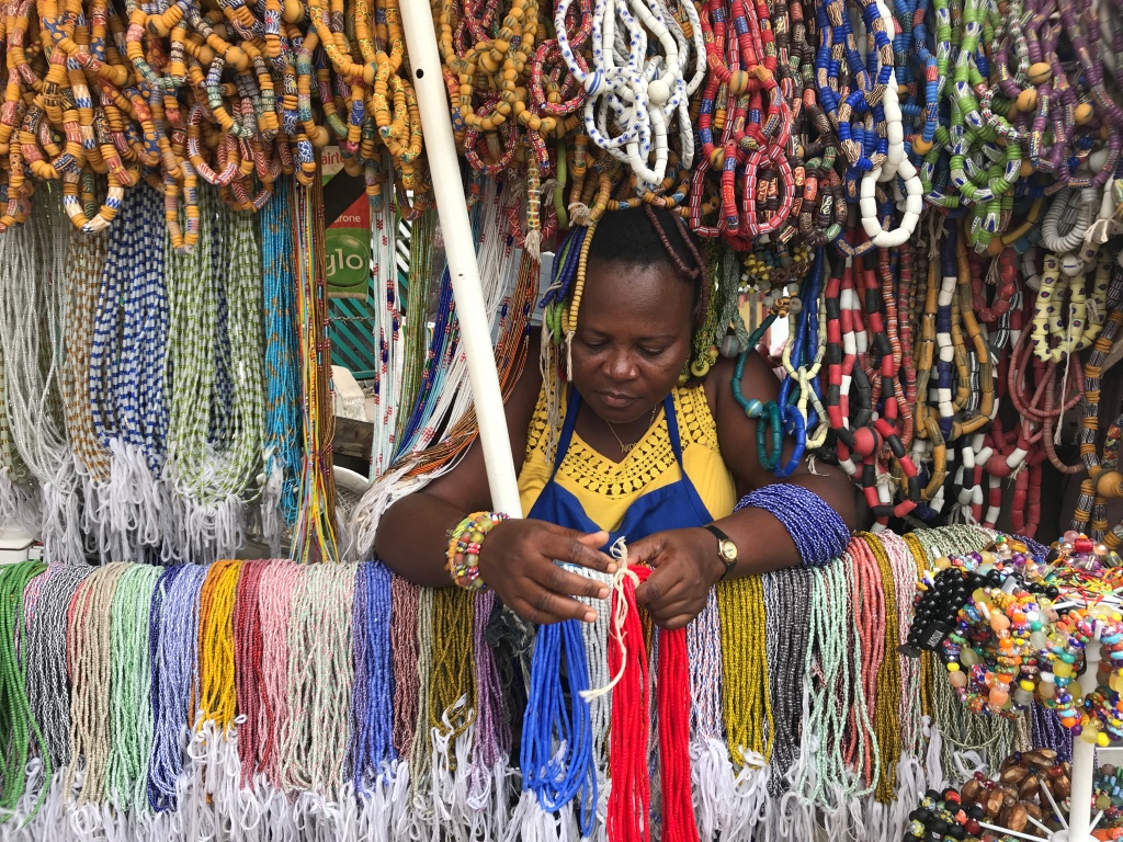 A lady selling Ghanaian beads at Makola Market Accra
