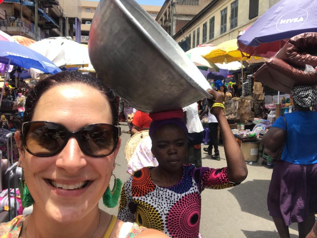 Kayayo girl carrying a silver bowl at Makola Market