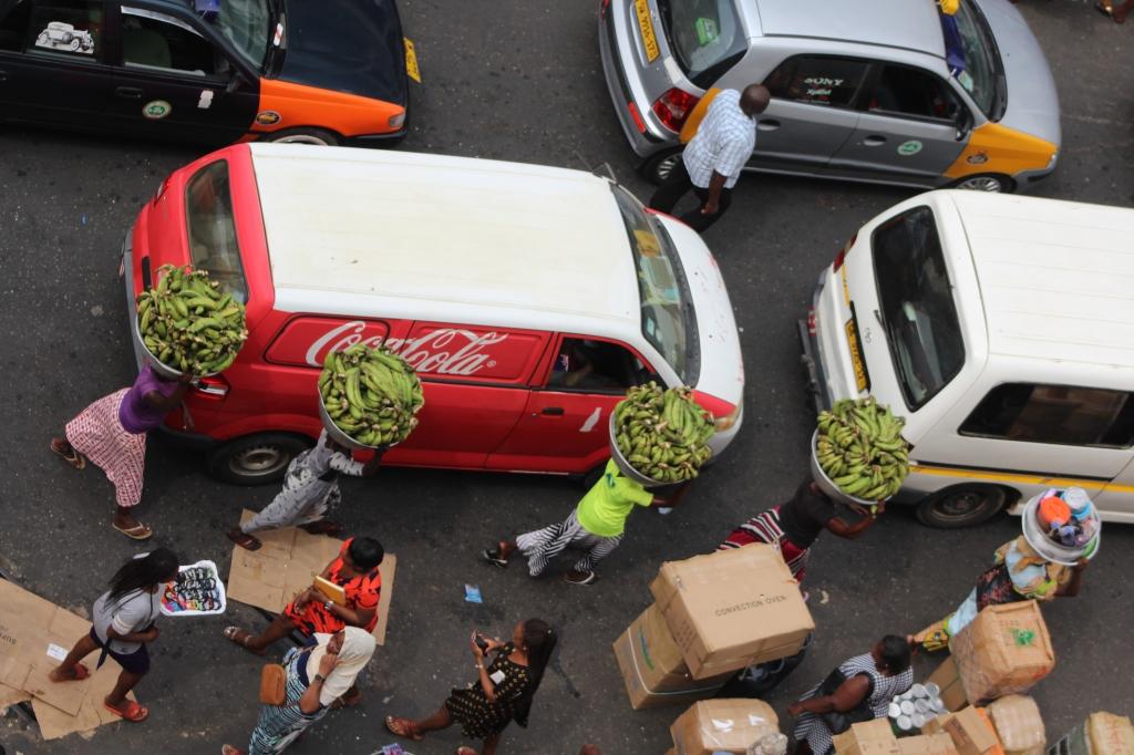Kayayo girls at Makola Market carrying silver bowls of plantain