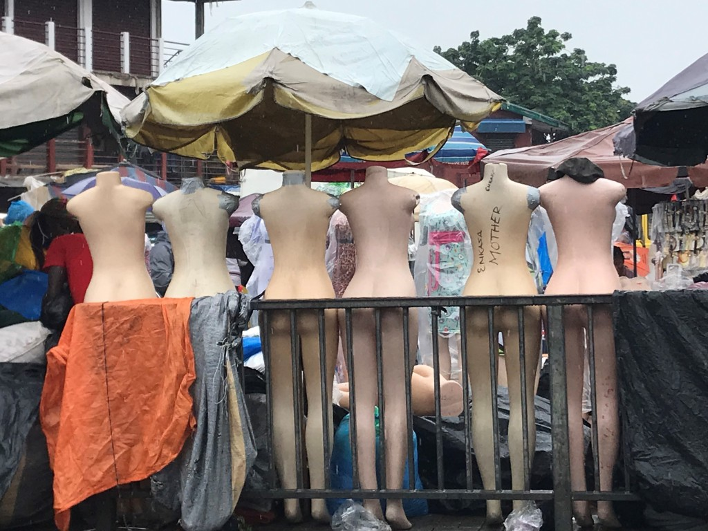 Mannequins are not clothed as it is raining so there are numerous naked mannequins at the Makola market