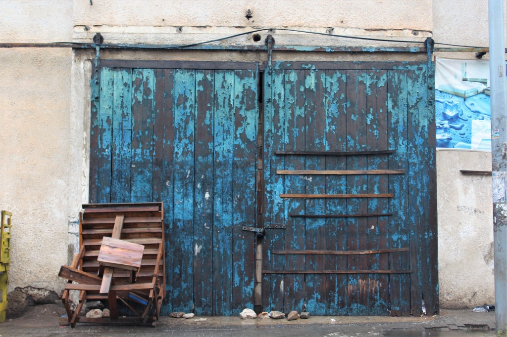 A beautiful blue door in old Accra with paint peeling from it.