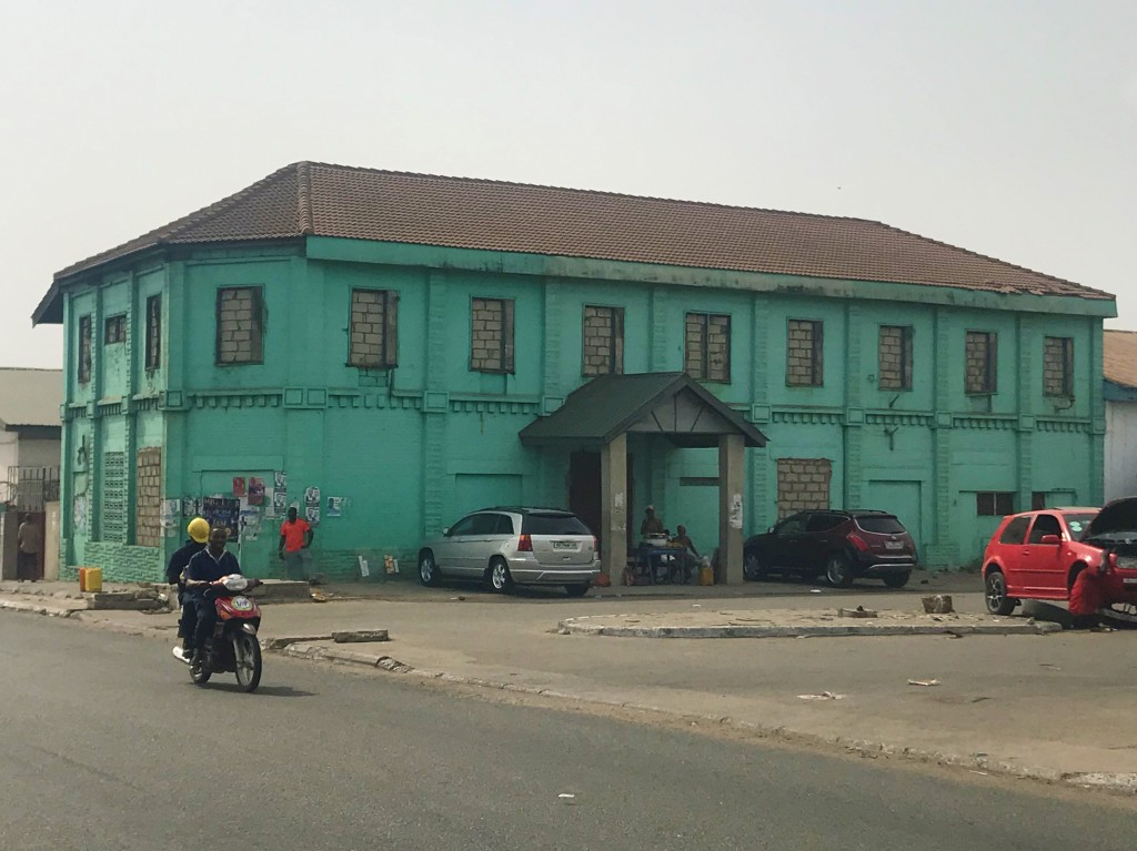 Picadilly biscuit factory a bright teal building in Jamestown Accra