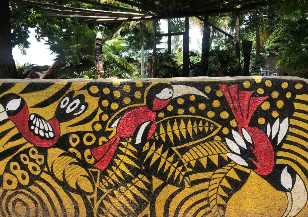A mural of birds painted on a wall at Kokorobite gardens, Kokrobite Ghana.